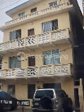 Photo 2 stories building with a pent house at Lagos...