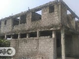 Photo Land With Uncompleted Building At Ojo